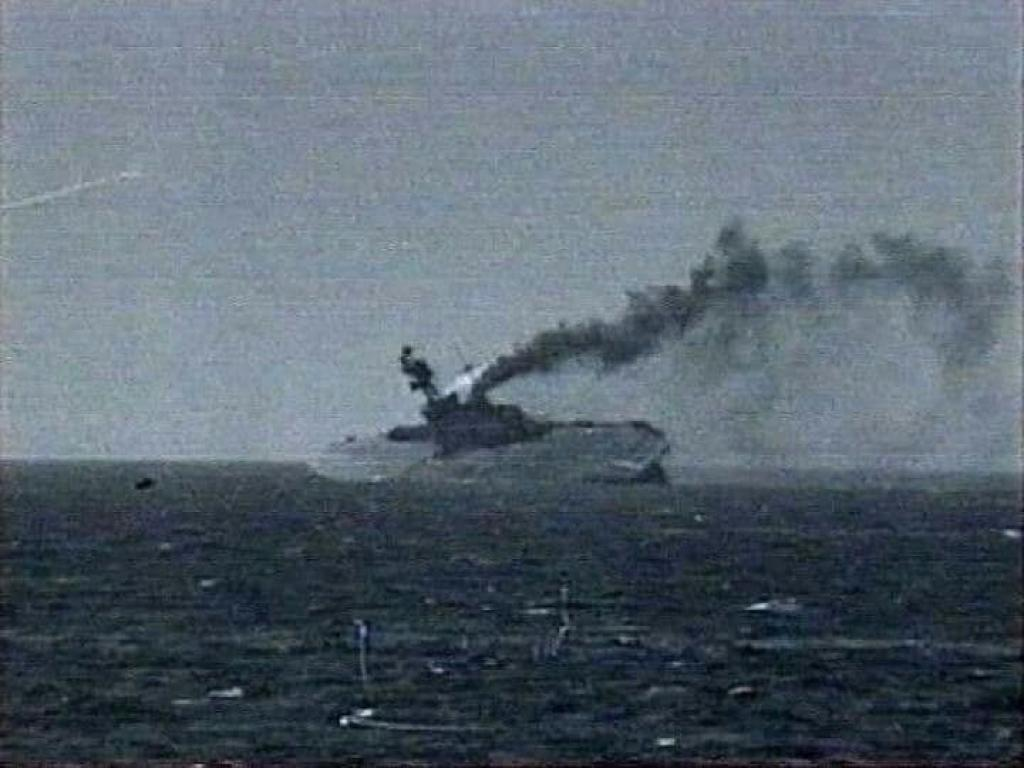 The HMS Eagle sinking after being hit by torpedoes.
