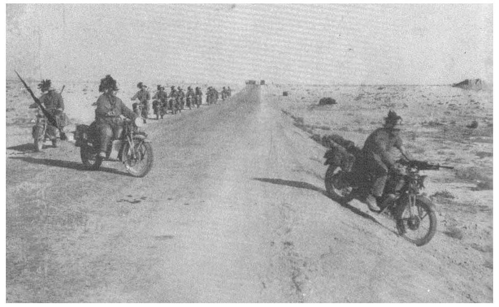 Bersaglieri riding Moto Guzzi motorcycles in North Africa during the siege of Tobruk.