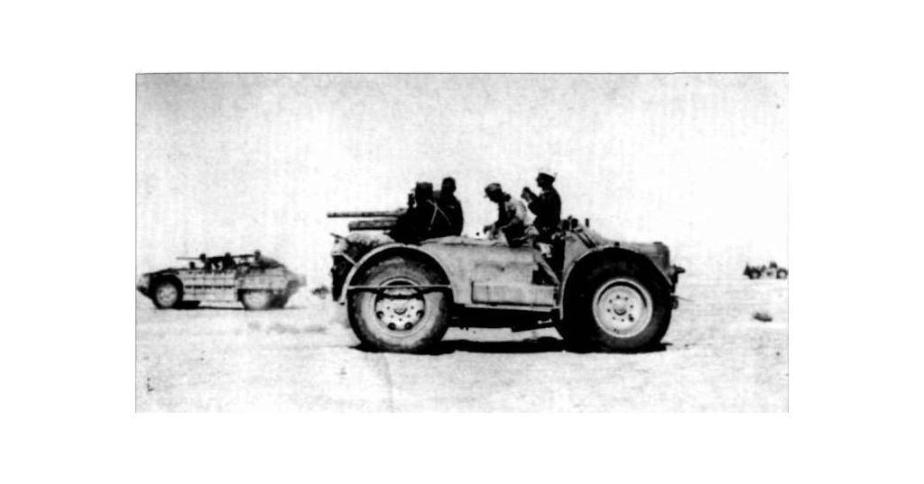 This photo clearly shows three vehicles from the original Raggruppamento Sahariano AS, the nearer is the SPA TL37 Camionetta AS mounting the 47/32 Anti-Tank Gun, the further vehicle is a AS.42 Sahariana, probably 790 B, 792 B, or 798 B as it appears to mount a 20mm and a single MG, and finally in the right distance can be seen a second AS.42 Sahariana.