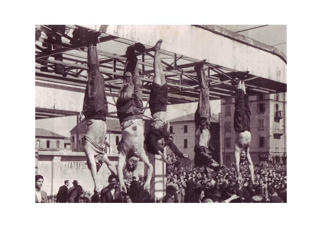 The bodies of Nicola Bombacci, Benito Mussolini, Claretta Petacci, Alessandro Pavolini, and Achille Starace strung up at Piazzale Loreto, Milano on 25 April 1945.
