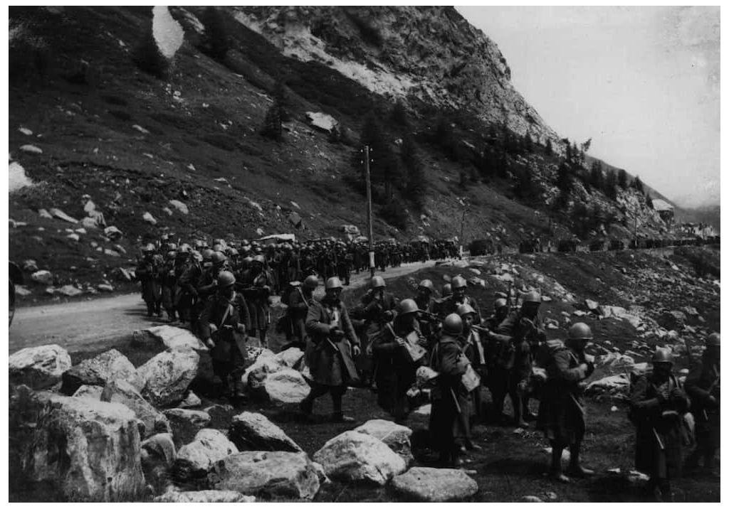 Italian troops marching through the Little St. Bernard pass on the French border in June, 1940.
