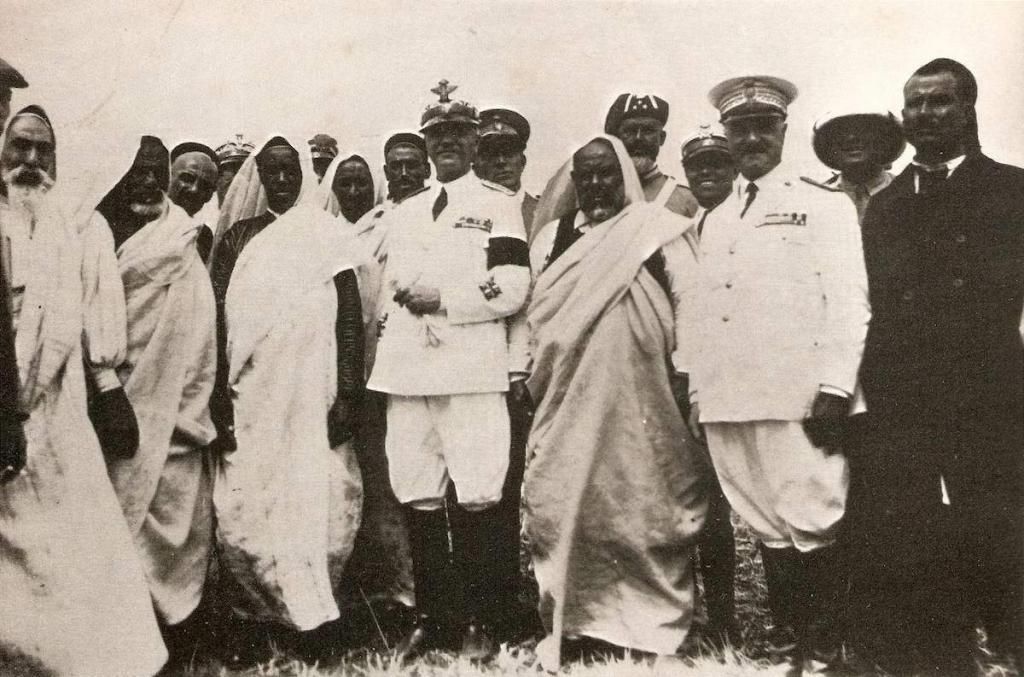 Badoglio (center) and Omar Muktar (2nd from left) after a negotiated compromise with the Senusite rebellion in Libya.