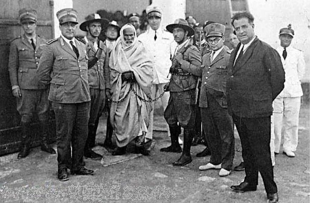 Omar Mokhtar arrested and in chains prior to his execution.