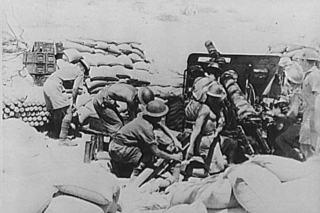 Indian soldiers firing British 18 pounders at Italian forces during the Battle of Keren.