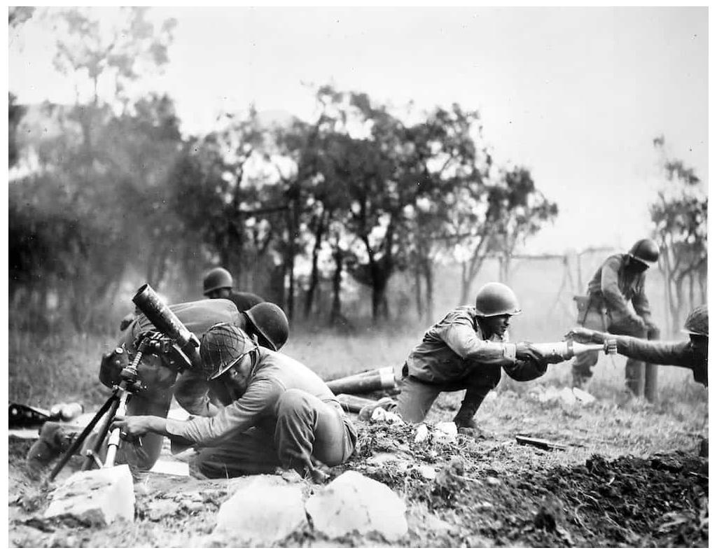 Buffalo soldiers from the 92nd Infantry Division provide mortar support at Massa, Italy in 1944.