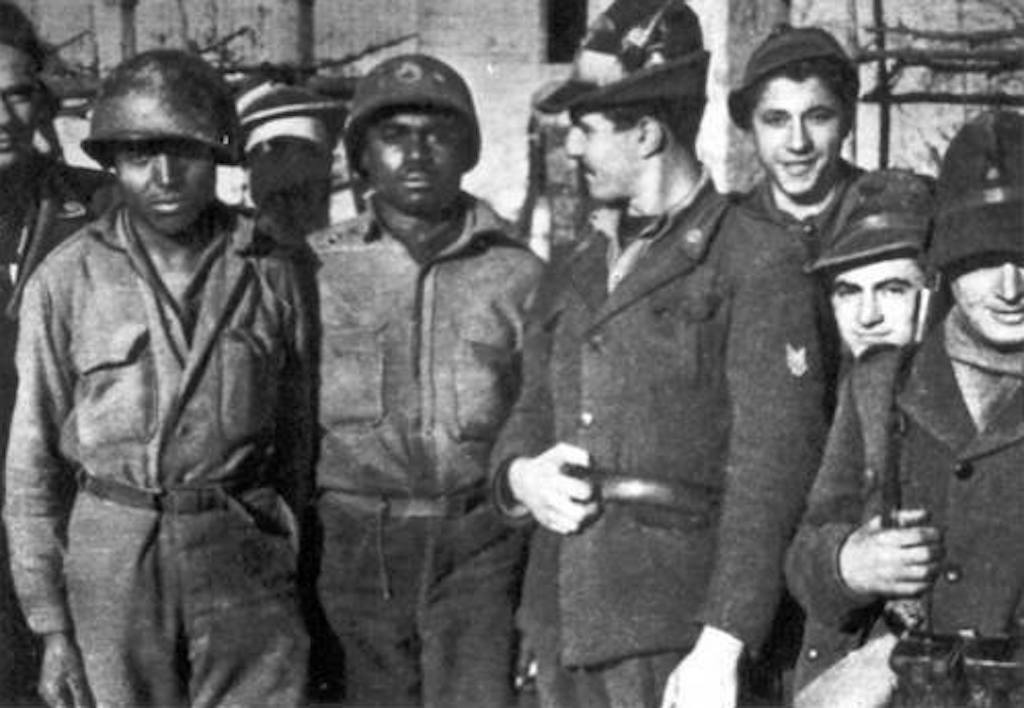 Two African American Buffalo Soldiers from the 92nd Infantry Division are captured as Prisoners of War by the Italian Alpini.