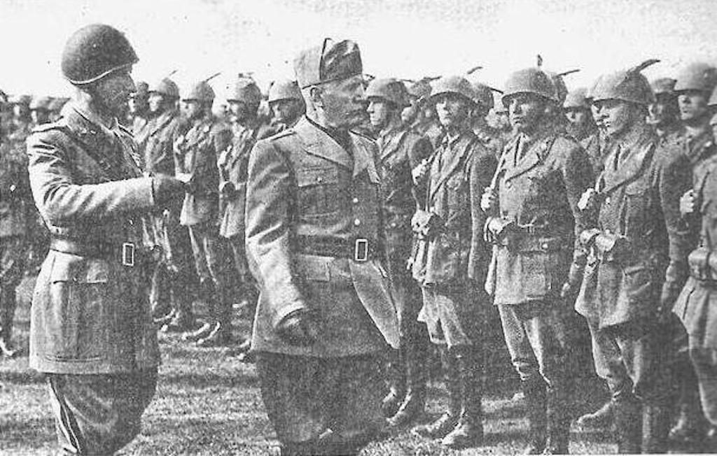 General Mario Carloni (L), Commander of the Monterosa Division reviews his troops with Benito Mussolini at the Munzingen training grounds.