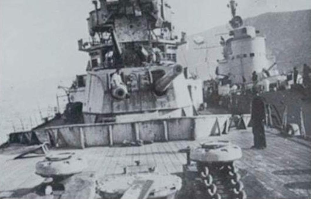 A photo of the crippled HMS York. The Italian torpedo boat Sirio is moored alongside.