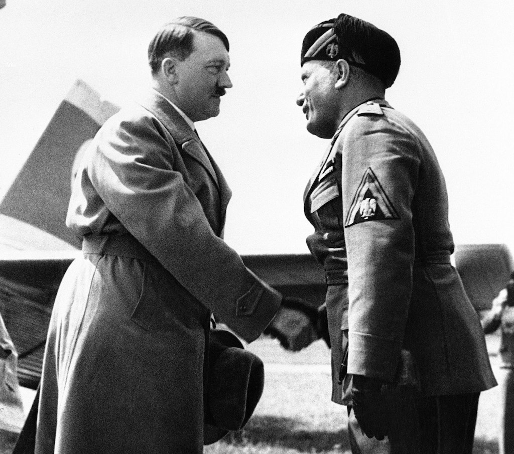 Hitler meets Mussolini for the first time in Italy, 14 June 1934.