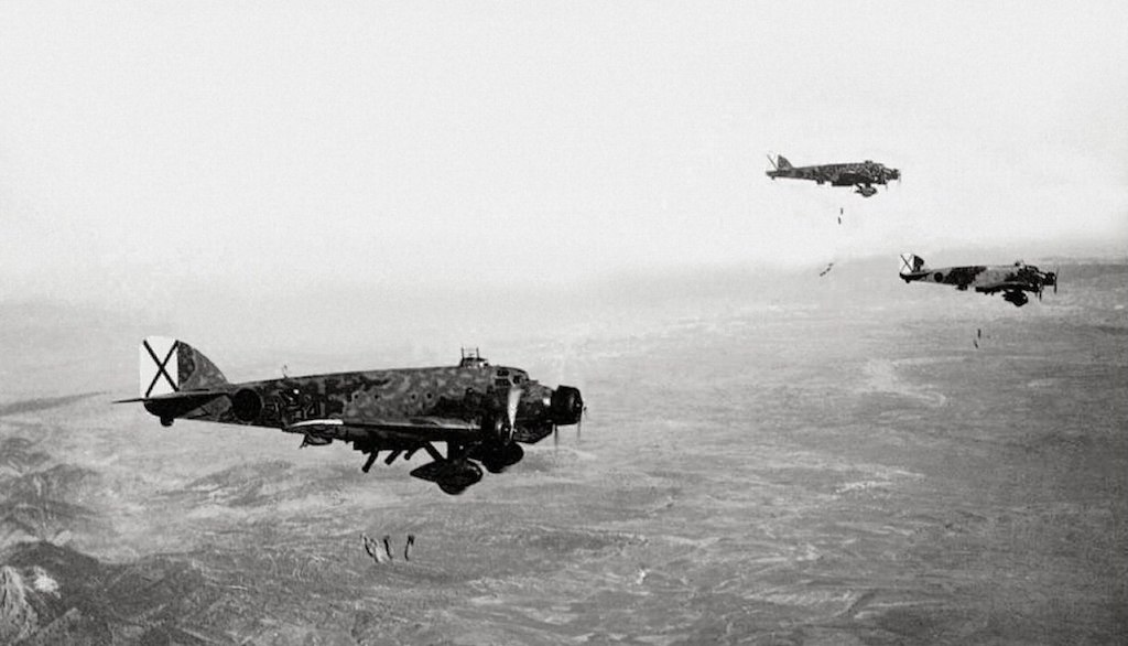 Before World War Two, Italian Savoia Marchetti SM.81 bombers drop ordnance on Spanish soil in 1936.