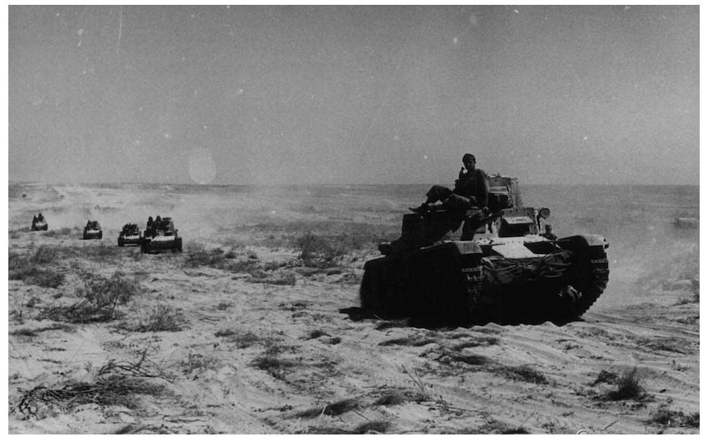 Tanks advance to the border in the Italian invasion of Egypt.