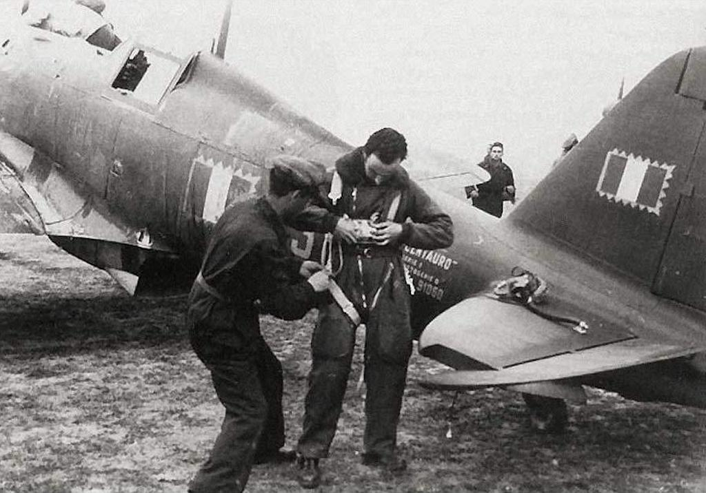 A pilot making preparations to fly the Fiat G55 Centauro.