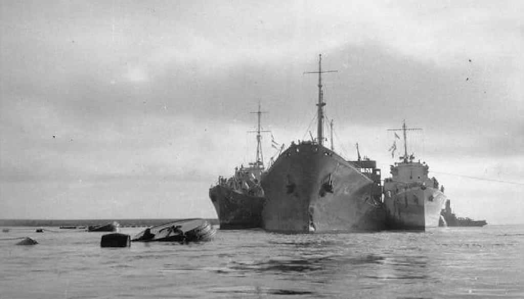 The severely damaged tanker Ohio arrives in Malta supported by two Royal Navy destroyers at the conclusion of Operation Pedestal.