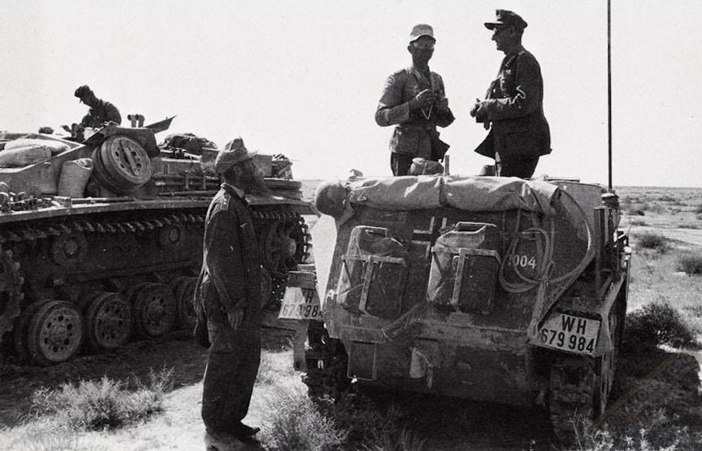 General Ulrich Kleemann, German 90th Light Division, speaks to a photographer on a SdKfz. 250 half-track command vehicle.