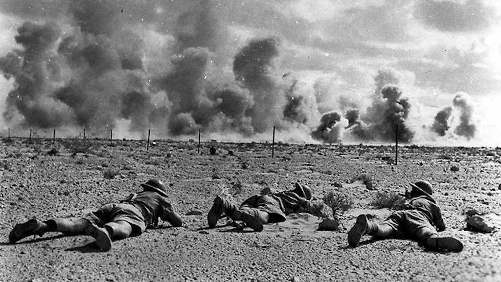 Australian troops advancing toward the line of fire.