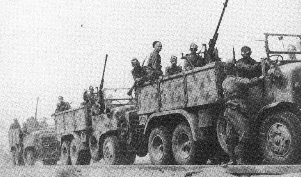 Giovani Fascisti riding SPA Dovunque 35 trucks mounted with Breda da 20/65 machine guns.