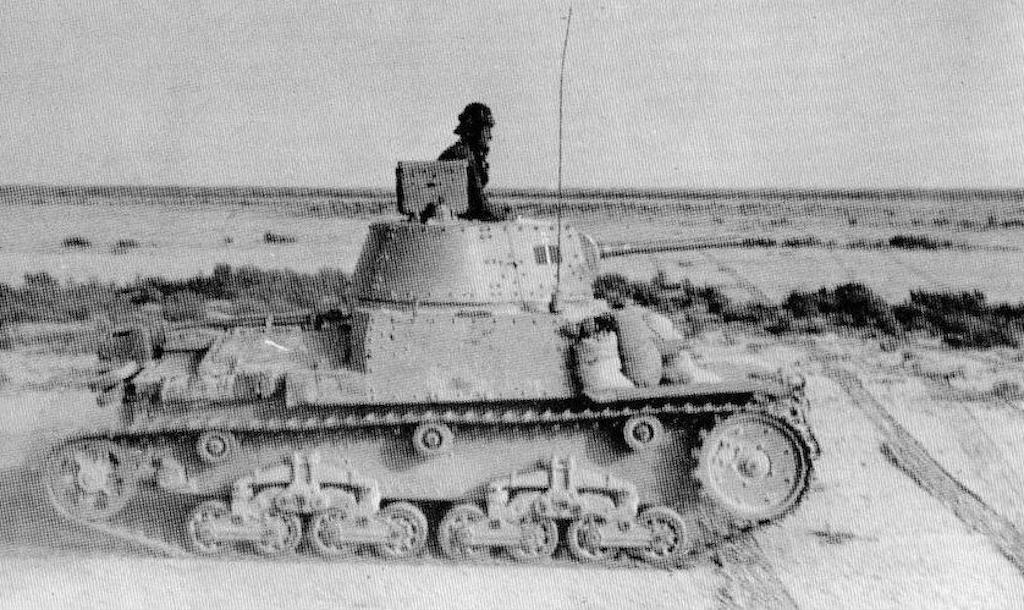 A Fiat M13/40 in North Africa. Notice the sandbags in the font being used for additional armor protection.