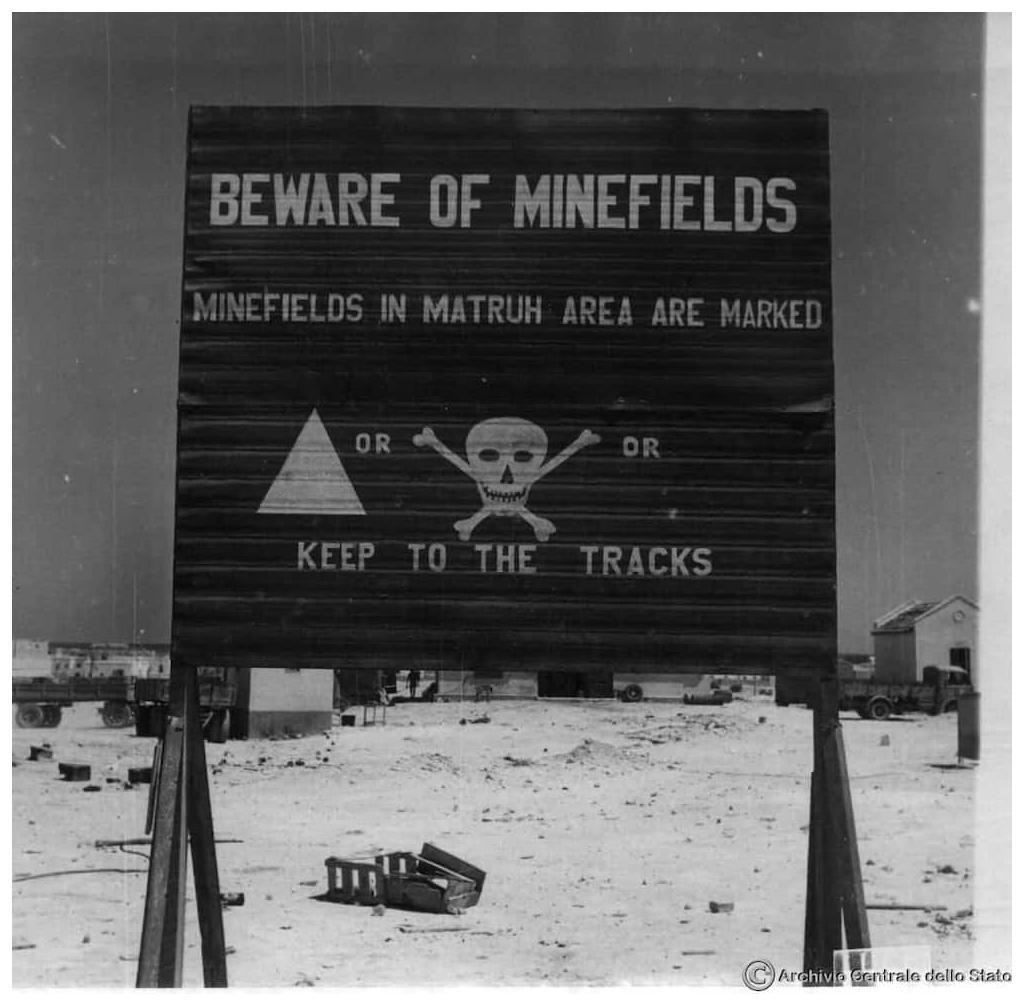A sign warning of the a minefield in Mersa Matrouh. Image credit: Archivio Centrale dello Stato.