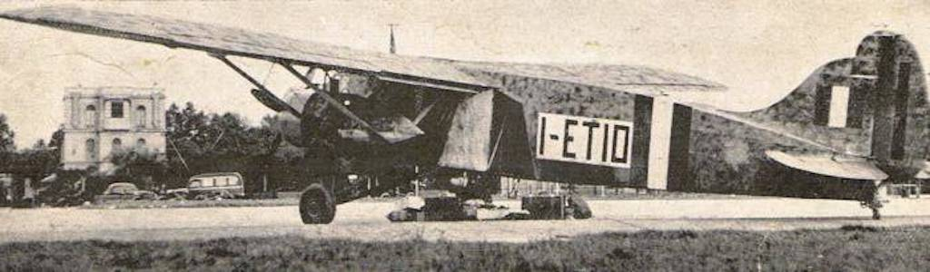 The Caproni Ca148 with supplies laying on the tarmac.