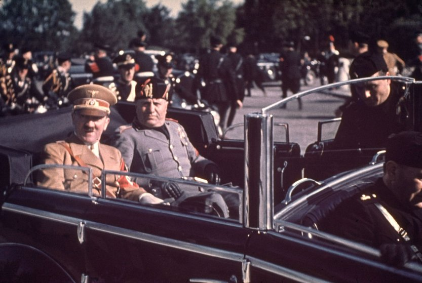 Adolf Hitler visits Benito Mussolini in Italy.