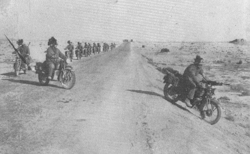 Bersaglieri riding Moto Guzzi motorcycles in North Africa.