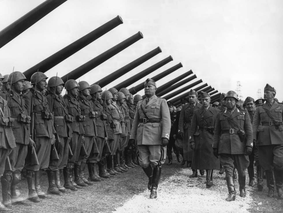 Mussolini reviewing troops