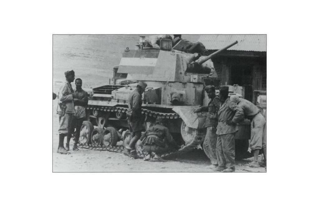 Pavia division inspecting a British A9 Cruiser tank pressed into Italian service.