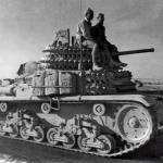 This Fiat-Ansaldo M1441 can be seen with tracks being used for additional armor protection.