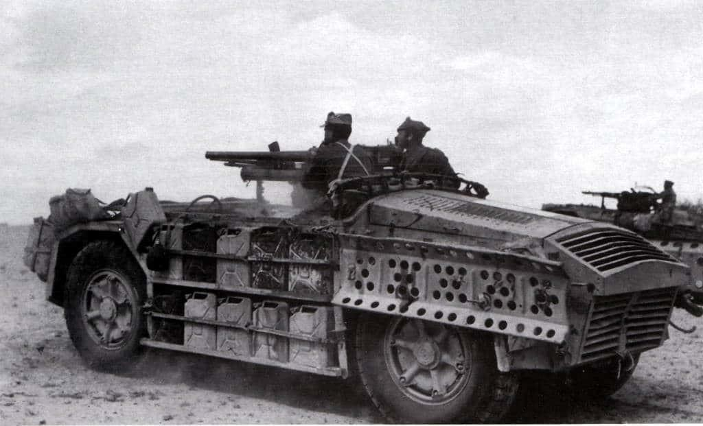"Above photo displays pair of ""Sahariane"" on patrol in North Africa. These are probably from the first unit formed - the ""Raggruppamento Sahariano AS"" and provide excellent details of the vehicles. The furthert vehicle mounts the Breda 20mm L/65 AA Gun (which was used as a dual purpose weapon and usually engaged ground targets), while the closest one mounts the 47mm L/32 Gun. Both vehicles clearly display the stowage arrangement with racks of ""Jerry Cans"" along the sides, and sand chutes can be seen hanging above the rear wheel of the further vehicle. The typical crew of 3-4 men is clearly evident, the driver's position at the extreme front of the vehicle clearly visible."