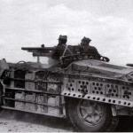 "Above photo displays pair of ""Sahariane"" on patrol in North Africa. These are probably from the first unit formed - the ""Raggruppamento Sahariano AS"" and provide excellent details of the vehicles. The furthert vehicle mounts the Breda 20mm L/65 AA Gun (which was used as a dual purpose weapon and usually engaged ground targets), while the closest one mounts the 47mm L/32 Gun. Both vehicles clearly display the stowage arrangement with racks of ""Jerry Cans"" along the sides, and sand chutes can be seen hanging above the rear wheel of the further vehicle. The typical crew of 3-4 men is clearly evident, the drivers position at the extreme front of the vehicle clearly visible."