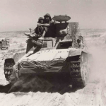 The commander and gunner can be seen on the M11/39. The driver is in the vehicle.