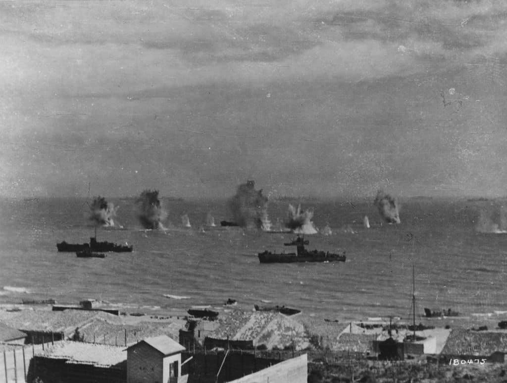 Axis aircraft bombing Allied ships at Gela.