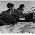 Giovani Fascisti manning a position in North Africa. The photo appears to be taken in the winter.