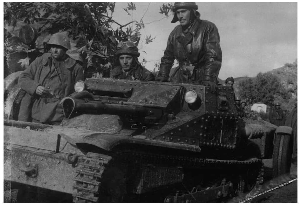 Esercito Italiano riding an L3/35 tankette on the Albanian/Greek border.