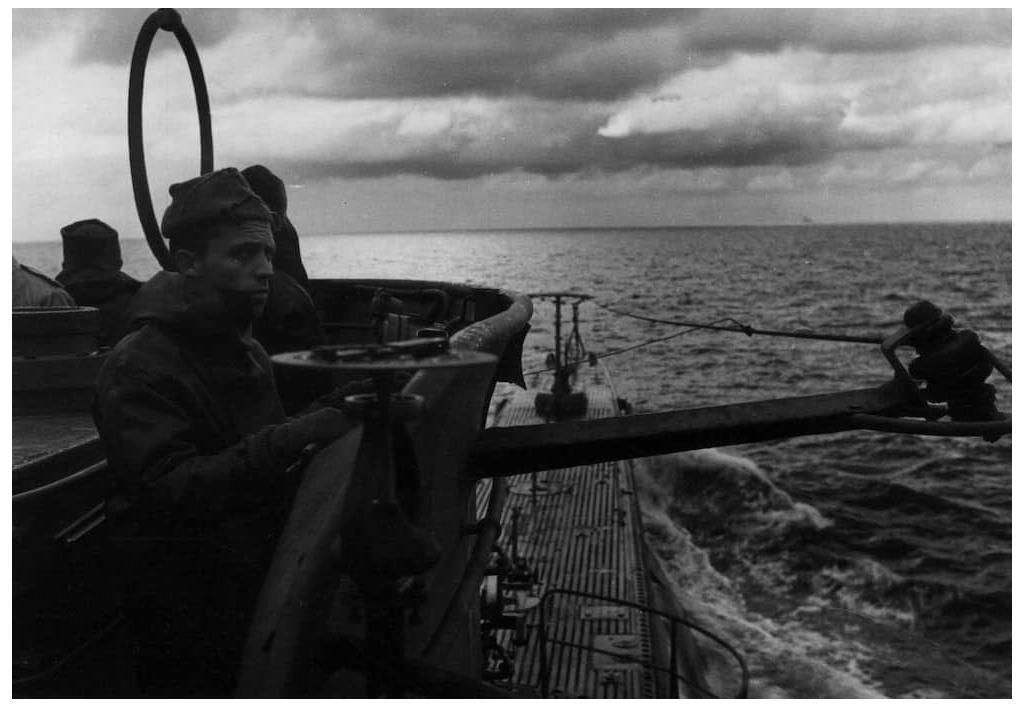 An Italian submariner acts as lookout in this 1941 photograph from the Archivio Centrale dello Stato.