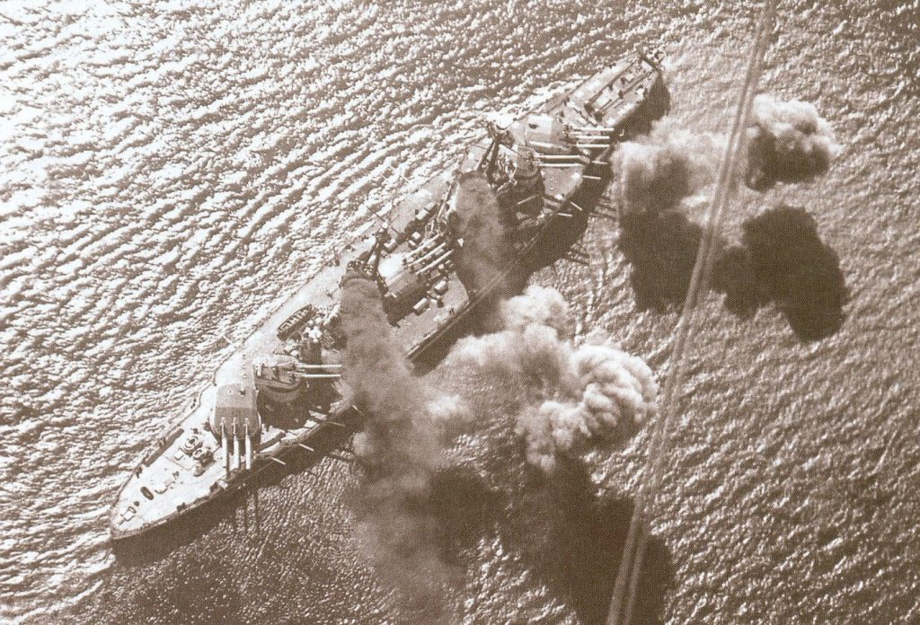 A birds eye view of the Andrea Doria firing her main guns.