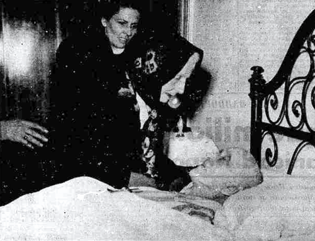Palmina Badoglio, sister of Pietro Badoglio, sits at his death bed. Image credit: Aldo Moiato, Stampa Sera 2 November 1956.