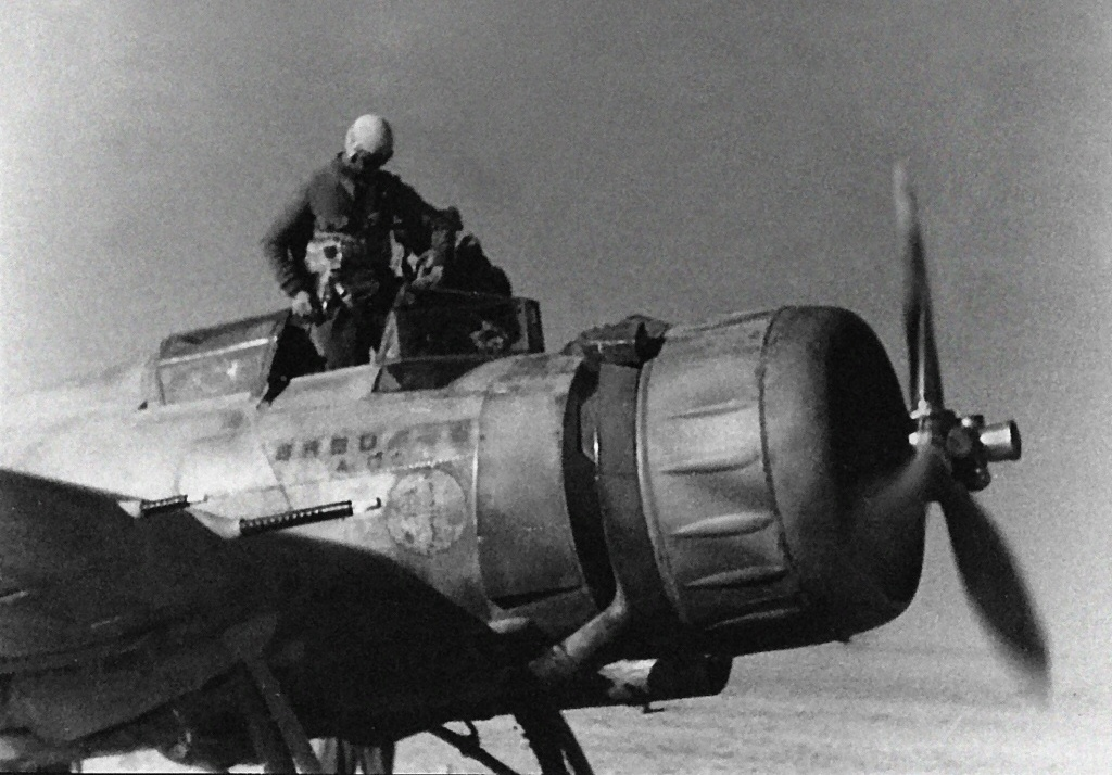 A pilot entering the cockpit of the Ba.65