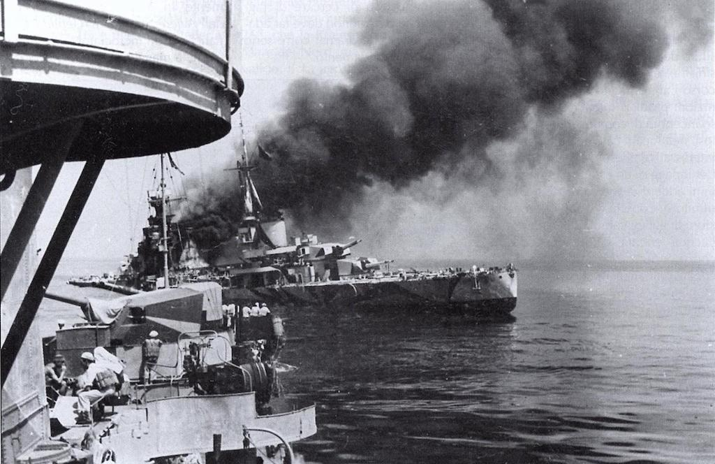 Bolzano in flames after being hit by a torpedo from the HMS Unbroken on 13 August 1942, Image taken on the Geniere.