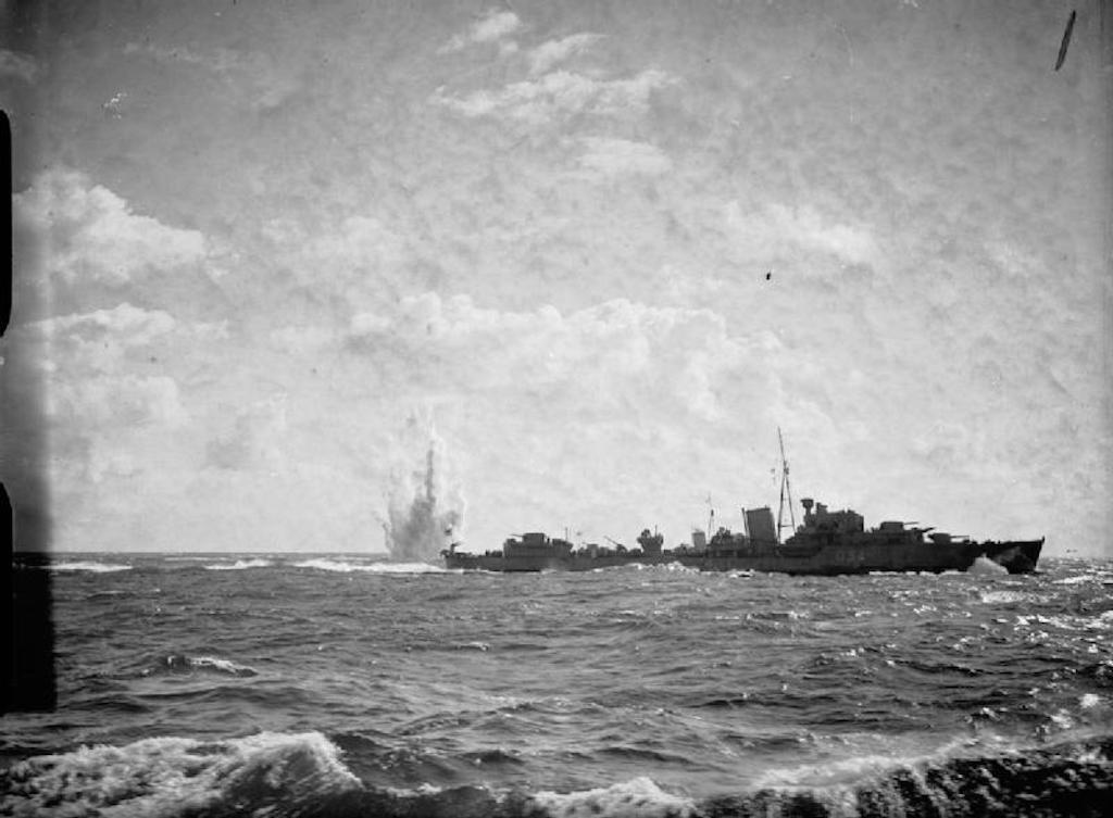 HMS Jaguar dropping depth charges.