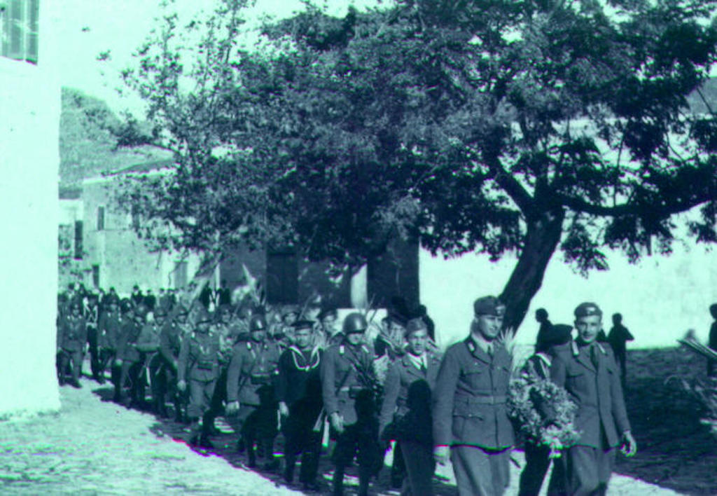 Italian Garrison on Kastellorizo marches to cemetery during ceremony to honor those killed during Operation Abstention, Nov 1941 Image: Vecchi.Altervista.org