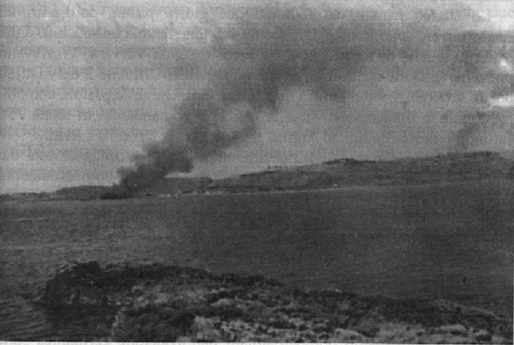 Italian artillery fire hits a German troop transport ship.