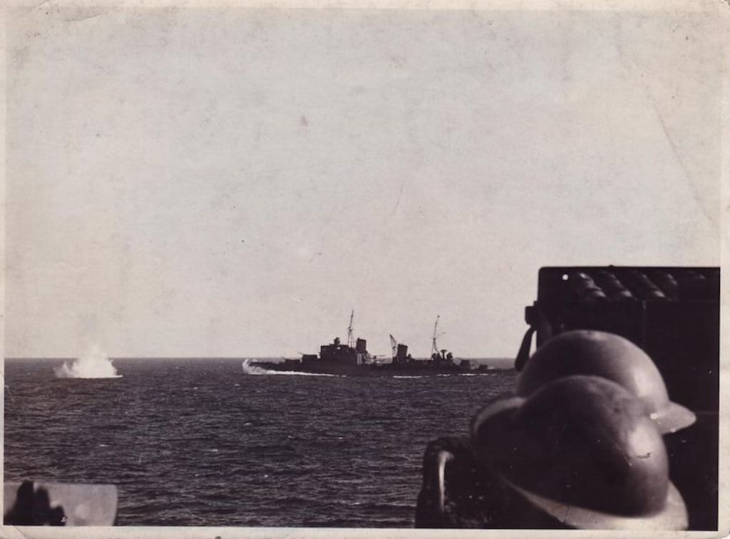 HMS Manchester receiving fire from Italian vessels during the Battle of Capo Teulada. Image take from HMS Sheffield.