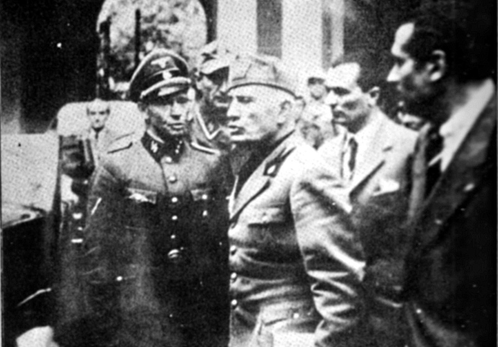 Last photo before Mussolini death, dated 25 April 1945. Here he is abandoning the Prefecture in Milan.