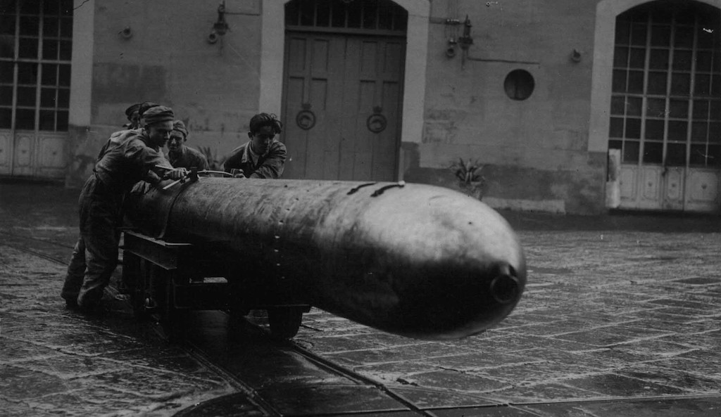 Unloading a torpedo at an Italian naval base in the winter of 1940.