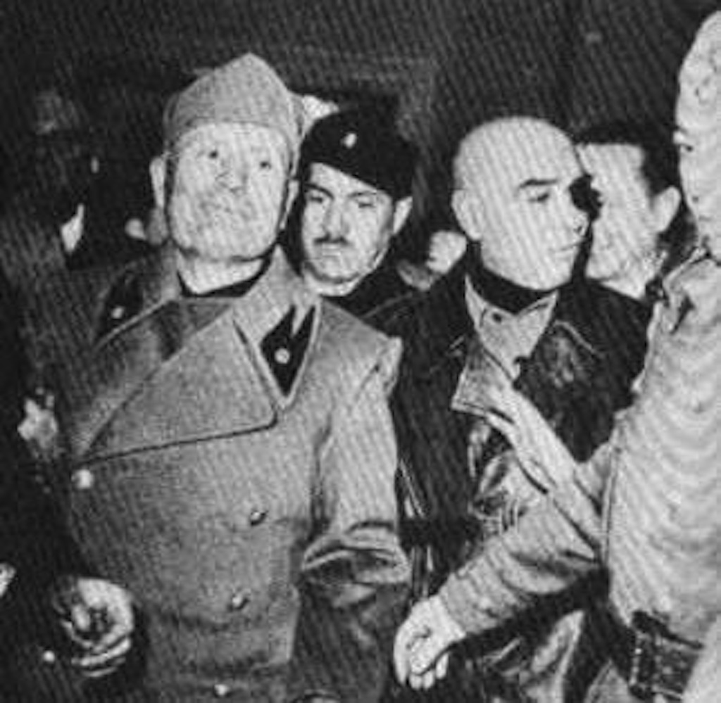 Mussolini (L), Pavolini (C)and F. Barracu (R) on 25 April 1945 in Milan. Three days before Mussolini's execution.