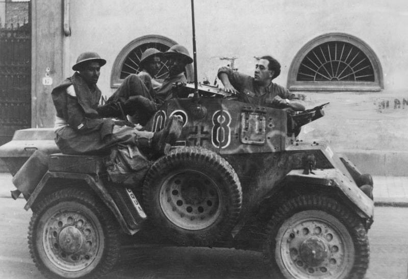 The Autoblinda Lince was one of the most used Italian armor in German Service. Here is one in German markings holding three Indian prisoners in Florence, 18 August 1944.